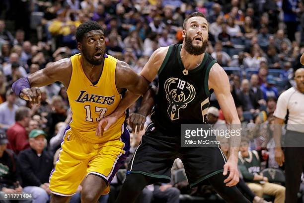 Miles Plumlee of the Milwaukee Bucks boxes out Roy Hibbert of the Los Angeles Lakers for the rebound during the third quarter at BMO Harris Bradley...