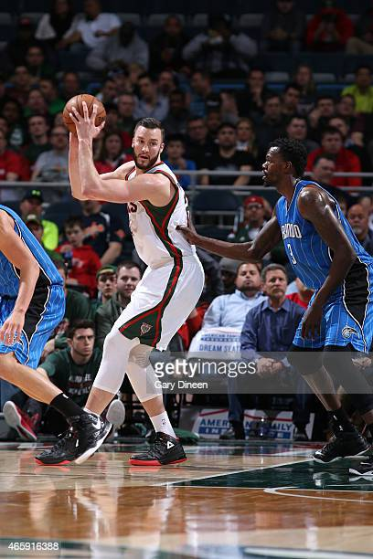 Miles Plumlee of the Milwaukee Bucks defends the ball against the Orlando Magic during the game on March 11 2015 at BMO Harris Bradley Center in...