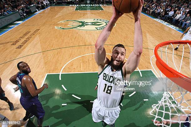 Miles Plumlee of the Milwaukee Bucks drives to the basket against the Charlotte Hornets on March 26 2016 at the BMO Harris Bradley Center in...