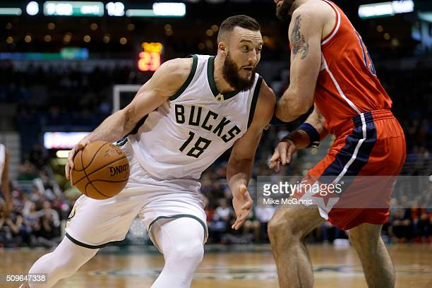 Miles Plumlee of the Milwaukee Bucks drives to the hoop during the first quarter against the Washington Wizards at BMO Harris Bradley Center on...