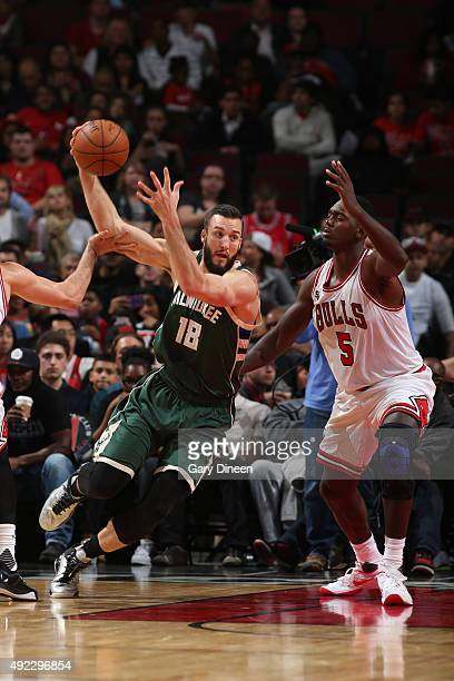 Miles Plumlee of the Milwaukee Bucks handles the ball against Bobby Portis of the Chicago Bulls during a preseason game on October 6 2015 at the...