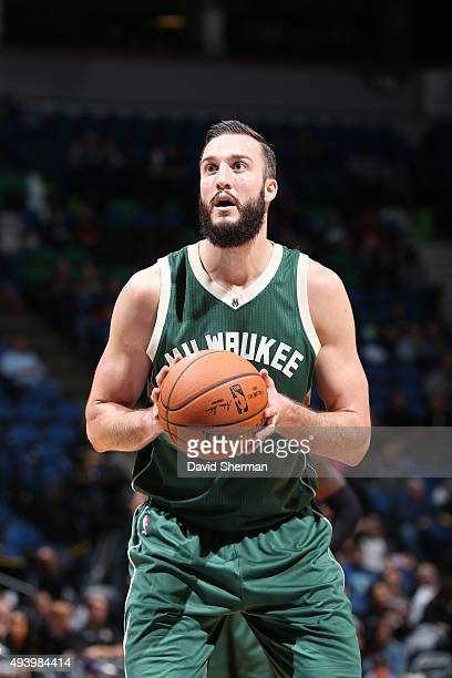 Miles Plumlee of the Milwaukee Bucks shoots a free throw against the Minnesota Timberwolves during a preseason game on October 23 2015 at Target...
