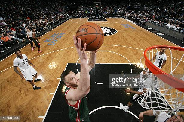 Miles Plumlee of the Milwaukee Bucks shoots against the Brooklyn Nets on March 20 2015 at Barclays Center in Brooklyn New York NOTE TO USER User...