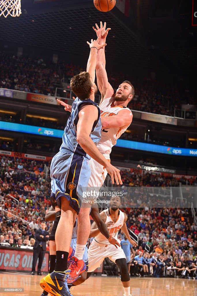 Miles Plumlee #22 of the Pheonix Suns shoots against Marc Gasol #33 of the Memphis Grizzlies on April 14, 2014 at U.S. Airways Center in Phoenix, Arizona.