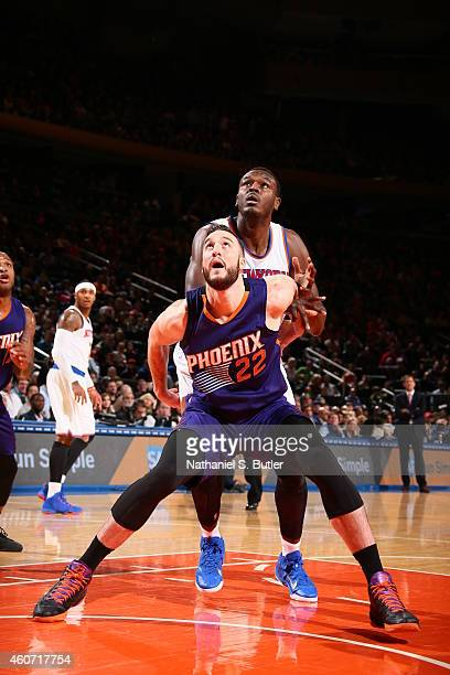 Miles Plumlee of the Phoenix Suns boxes out Samuel Dalembert of the New York Knicks during the game on December 20 2014 at Madison Square Garden in...