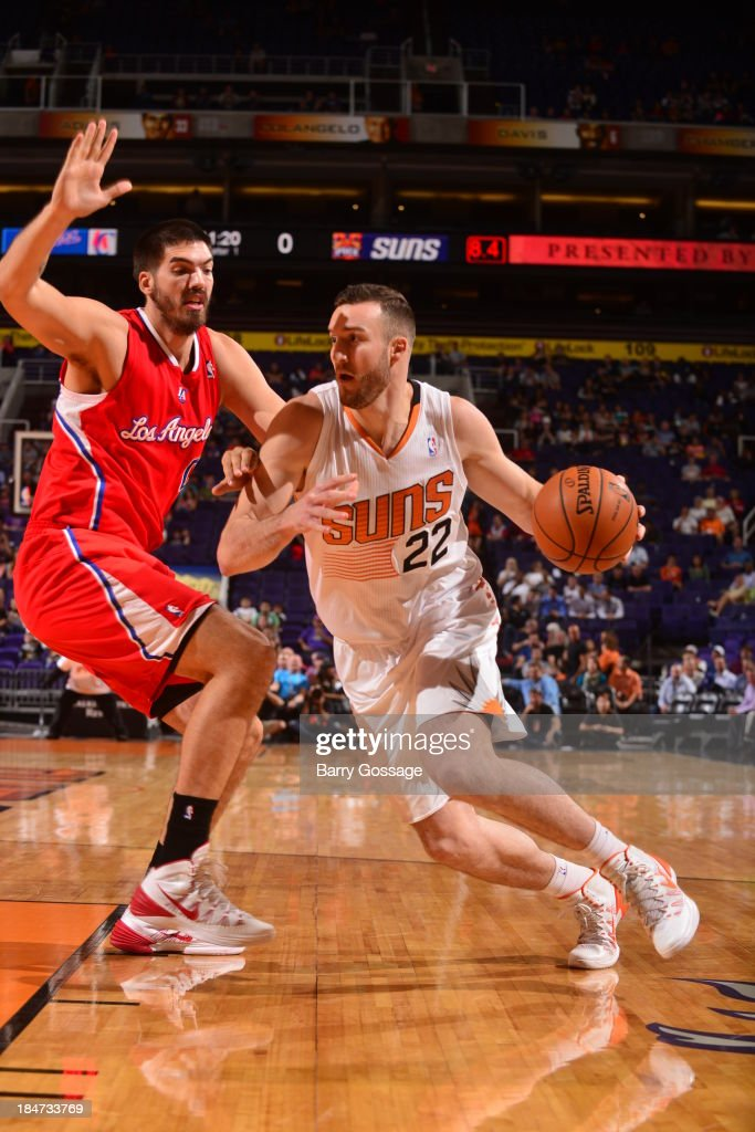 <a gi-track='captionPersonalityLinkClicked' href=/galleries/search?phrase=Miles+Plumlee&family=editorial&specificpeople=5645212 ng-click='$event.stopPropagation()'>Miles Plumlee</a> #22 of the Phoenix Suns drives against Byron Mullens #0 of the Los Angeles Clipper on October 15, 2013 at U.S. Airways Center in Phoenix, Arizona.