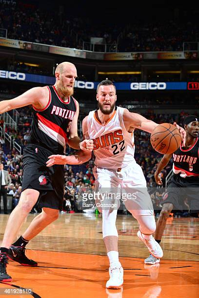 Miles Plumlee of the Phoenix Suns drives against Chris Kaman of the Portland Trail Blazers on January 21 2015 at US Airways Center in Phoenix Arizona...
