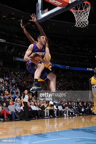 Miles Plumlee of the Phoenix Suns drives to the basket against the Denver Nuggets on December 20 2013 at the Pepsi Center in Denver Colorado NOTE TO...