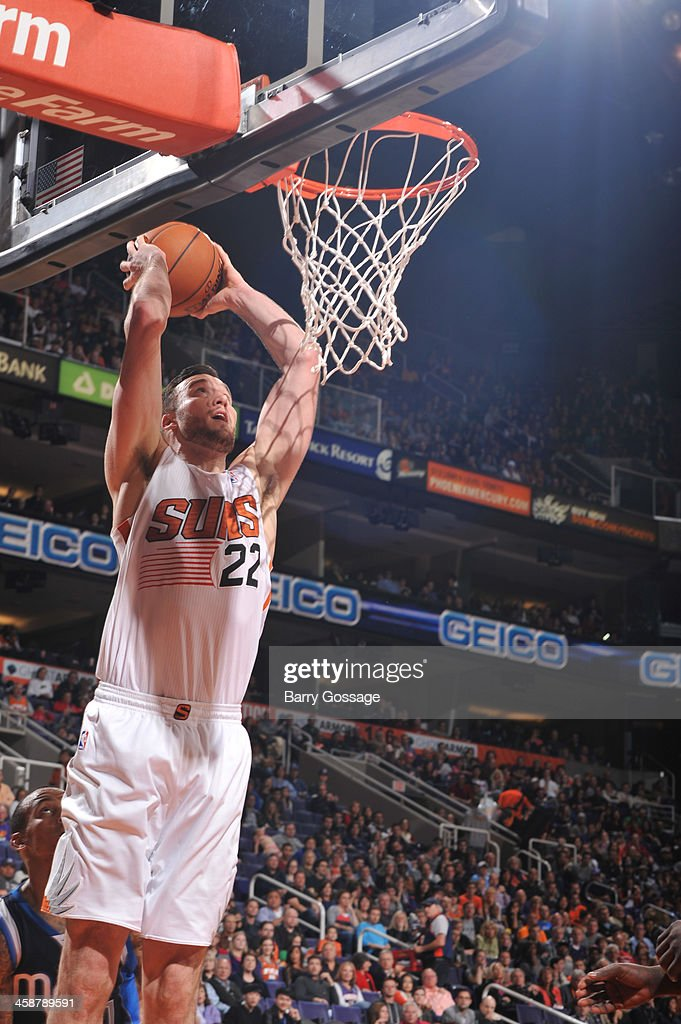 Miles Plumlee #22 of the Phoenix Suns dunks against the Dallas Mavericks on December 21, 2013 at U.S. Airways Center in Phoenix, Arizona.
