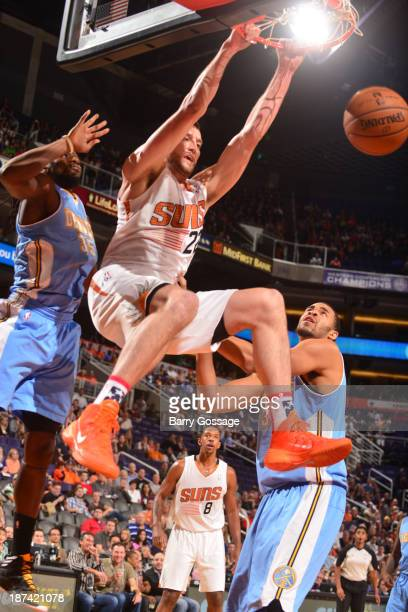 Miles Plumlee of the Phoenix Suns dunks against the Denver Nuggets on November 8 2013 at US Airways Center in Phoenix Arizona NOTE TO USER User...