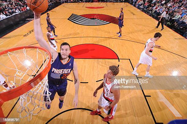Miles Plumlee of the Phoenix Suns dunks against the Portland Trail Blazers on October 9 2013 at the Moda Center Arena in Portland Oregon NOTE TO USER...