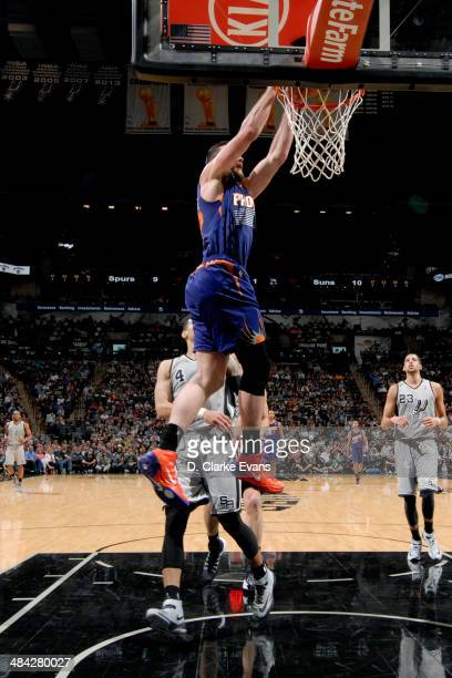 Miles Plumlee of the Phoenix Suns dunks against the San Antonio Spurs at the ATT Center on April 11 2014 in San Antonio Texas NOTE TO USER User...