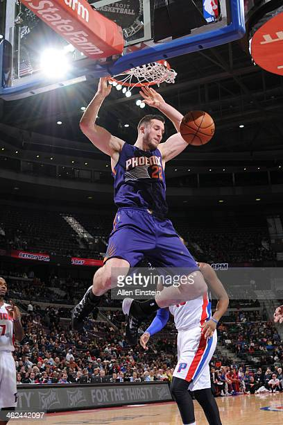 Miles Plumlee of the Phoenix Suns dunks the ball against the Detroit Pistons on January 11 2014 at The Palace of Auburn Hills in Auburn Hills...