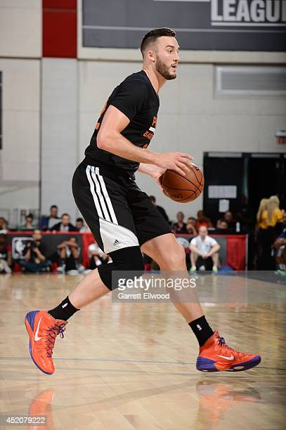 Miles Plumlee of the Phoenix Suns handles the ball against the Golden State Warriors at the Samsung NBA Summer League 2014 on July 12 2014 at the Cox...