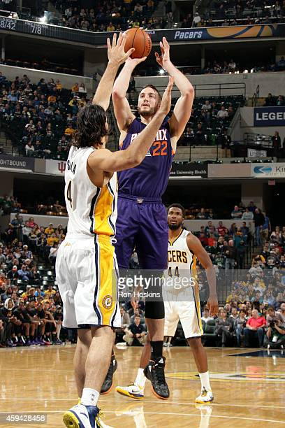 Miles Plumlee of the Phoenix Suns shoots against the Indiana Pacers on November 22 2014 at Bankers Life Fieldhouse in Indianapolis Indiana NOTE TO...