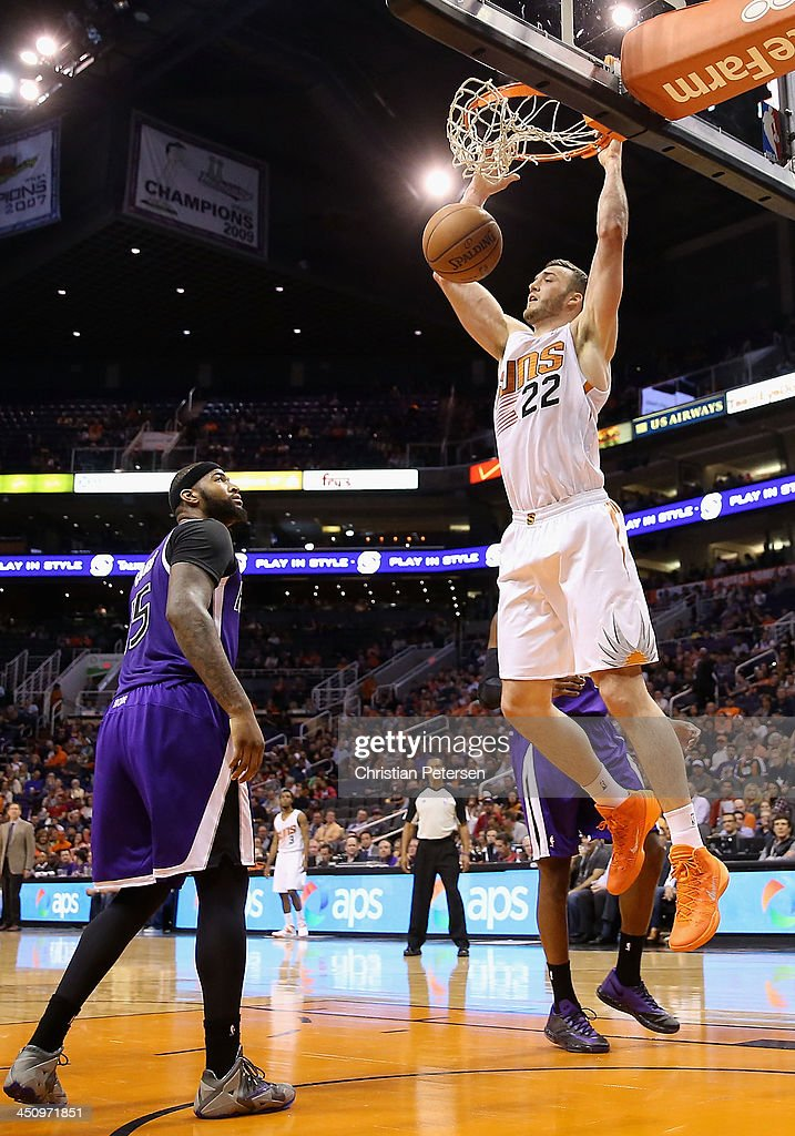 <a gi-track='captionPersonalityLinkClicked' href=/galleries/search?phrase=Miles+Plumlee&family=editorial&specificpeople=5645212 ng-click='$event.stopPropagation()'>Miles Plumlee</a> #22 of the Phoenix Suns slam dunks the ball against the Sacramento Kings during the NBA game at US Airways Center on November 20, 2013 in Phoenix, Arizona. The Kings defeated the Suns 113-106.