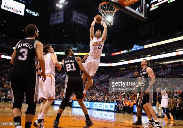 Miles Plumlee of the Phoenix Suns slam dunks the ball against the San Antonio Spurs during the first half of the NBA game at US Airways Center on...