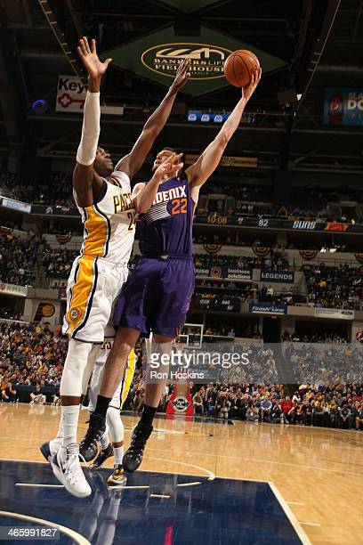 Miles Plumlee of the Phoenix Suns taking a shot during a game against the Indiana Pacers at Bankers Life Fieldhouse on January 30 2014 in...
