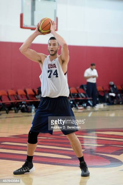 Miles Plumlee of the USA Mens Select team handles the ball against the USA Mens Basketball team at the Mendenhall Center at the University of Nevada...