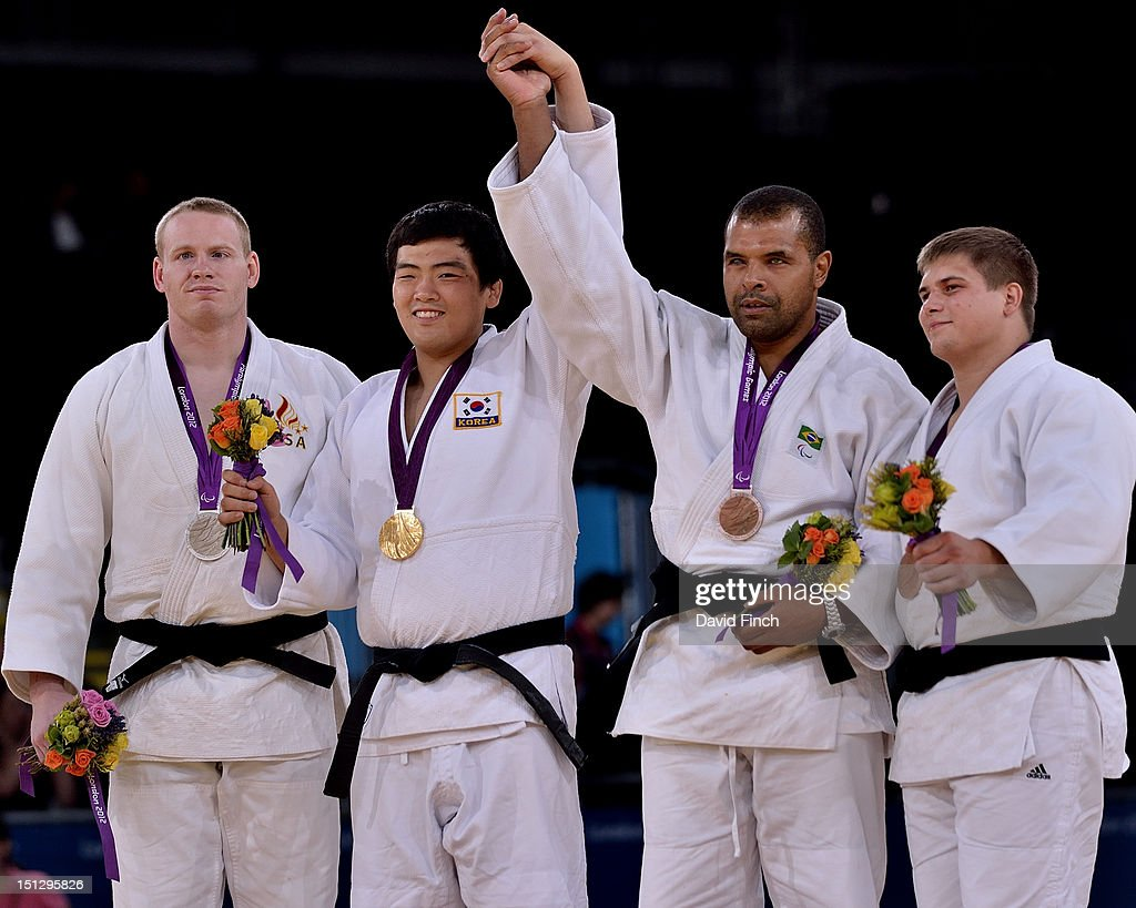 Miles Porter of the USA (Silver), Gwang-Geun Choi of Korea (Gold), AntonioTenorio of Brazil (Bronze) and Vladimir Fedin of Russia (Bronze) during the u100kgs medal ceremony on Day 3 of the London 2012 Paralympic Games at the ExCeL on April 30, 2012 in London, England.