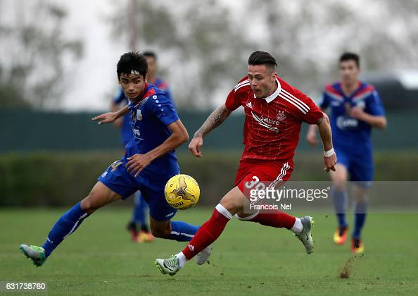 Miles Sorey of Aberdeen FC competes for the ball with Kobilov Islomson of FC Bunyodkor during the friendly match between Aberdeen FC and FC Bunyodkor...