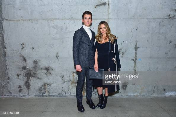 Miles Teller and Keleigh Sperry attend Boss Front Row NYFW Men's at Skylight Modern on January 31 2017 in New York City