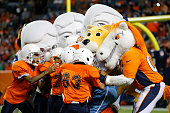 Miles the Denver Broncos mascot and his teammates Rocky the Denver Nuggets mascot and the Mount Rushmore Presidents team up against the Denver Boys...