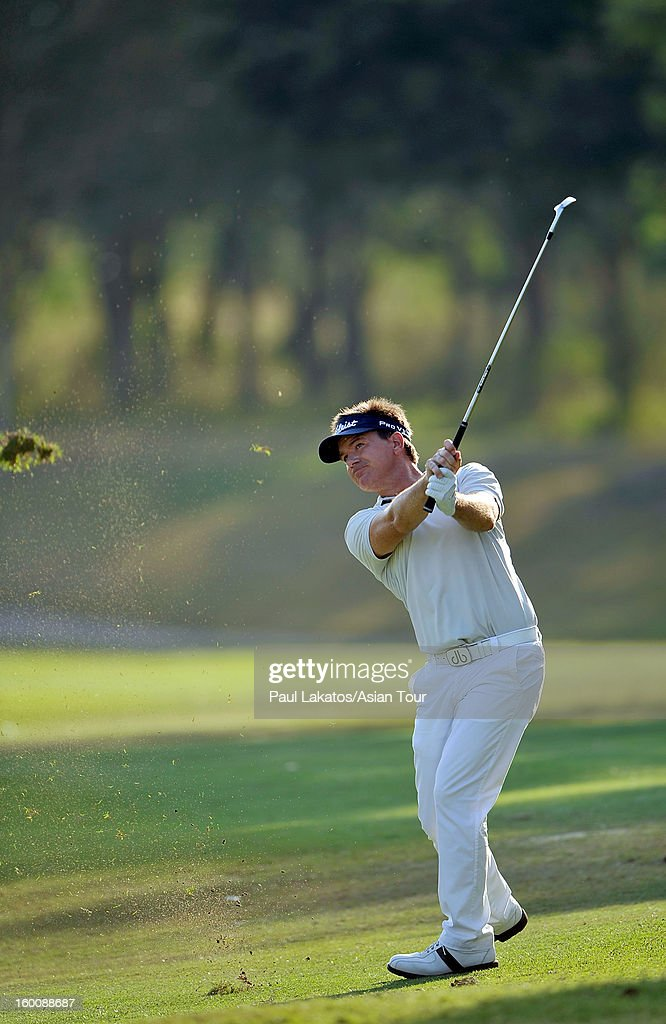 Miles Tunnicliff of England plays a shot during round four of the Asian Tour Qualifying School Final Stage at Springfield Royal Country Club on January 26, 2013 in Hua Hin, Thailand.