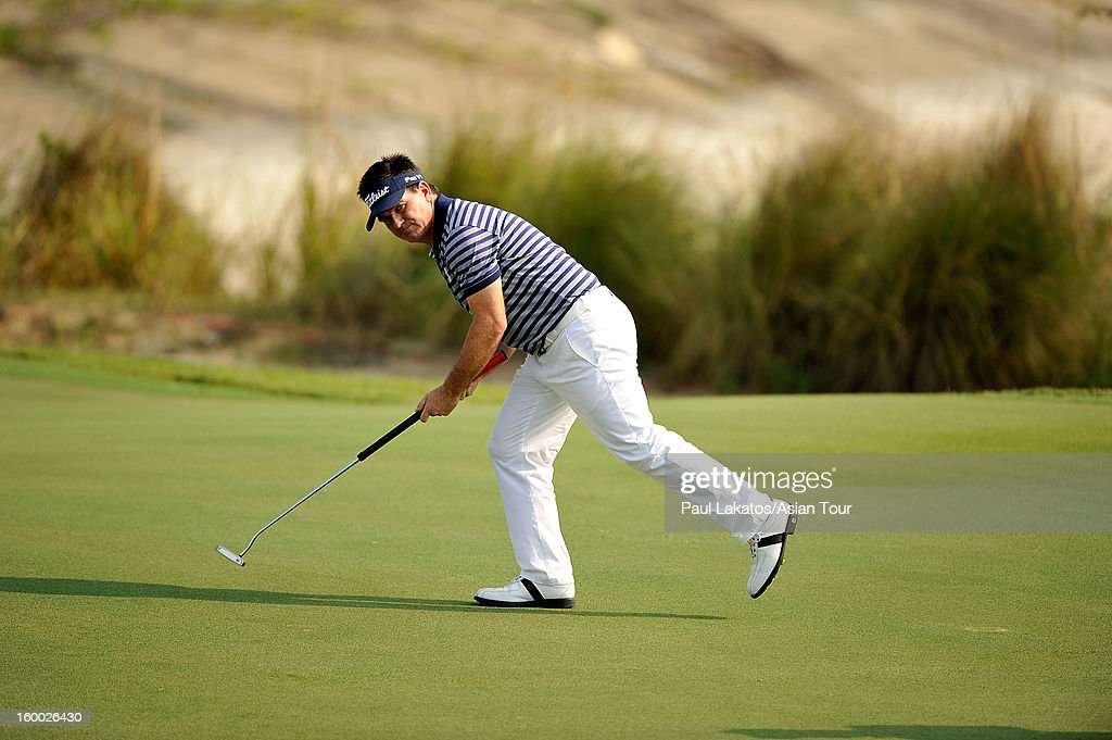 Miles Tunnicliff of England plays a shot during round three of the Asian Tour Qualifying School Final Stage at Springfield Royal Country Club on January 25, 2013 in Hua Hin, Thailand.