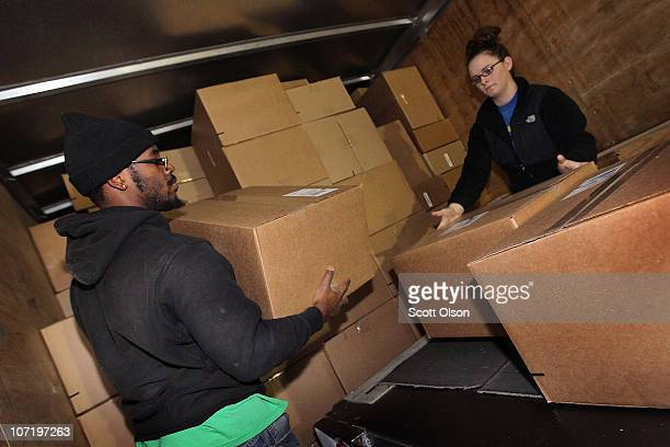 Miles Turner and Ashlee Bezak unload a truck at a UPS sorting facility on November 29 2010 in Hodgkins Illinois Shippers have geared up for the...