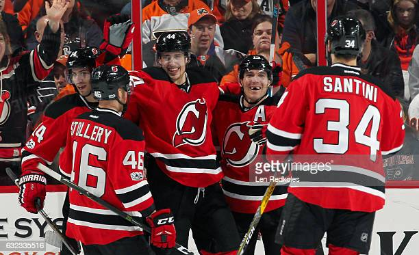 Miles Wood of the New Jersey Devils celebrates his second period goal against the Philadelphia Flyers with teammates Karl Stollery Adam Henrique...
