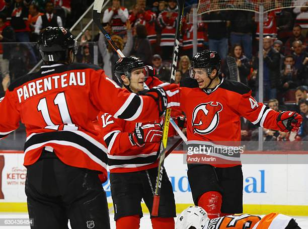Miles Wood of the New Jersey Devils is congratulated by his teammates after scoring a firstperiod goal against the Philadelphia Flyers during the...