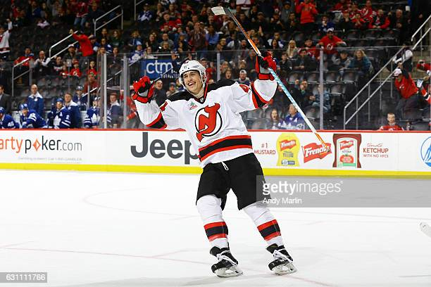 Miles Wood of the New Jersey Devils reacts to a goal by teammate Jon Merrill in the third period against the Toronto Maple Leafs at Prudential Center...