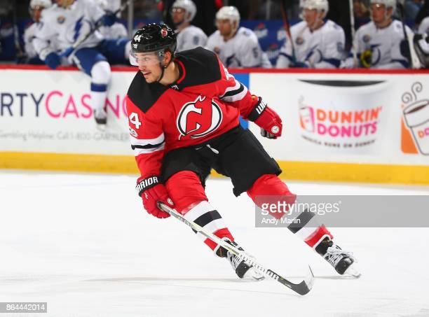 Miles Wood of the New Jersey Devils skates against the Tampa Bay Lightning during the game at Prudential Center on October 17 2017 in Newark New...