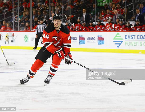Miles Wood of the New Jersey Devils skates against the Vancouver Canucks during the game at Prudential Center on December 6 2016 in Newark New Jersey