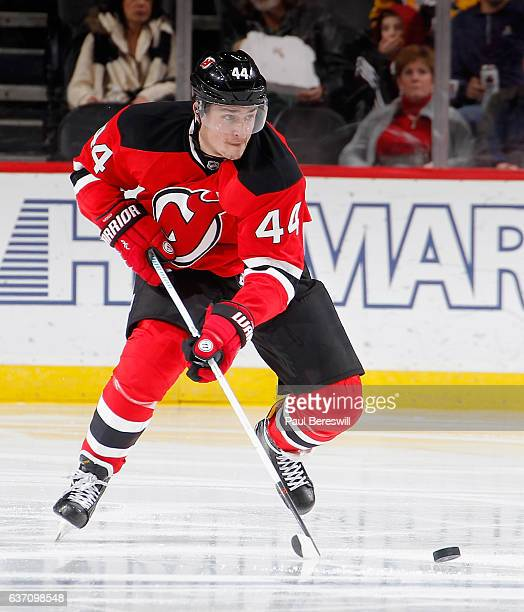 Miles Wood of the New Jersey Devils skates in an NHL hockey game against the Pittsburgh Penguins at Prudential Center on December 27 2016 in Newark...