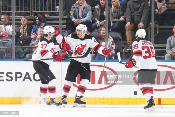 Miles Wood Pavel Zacha and Brian Gibbons of the New Jersey Devils celebrate after scoring a goal in the third period against the New York Rangers at...