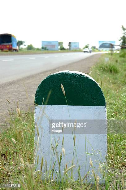 A milestone by a highway