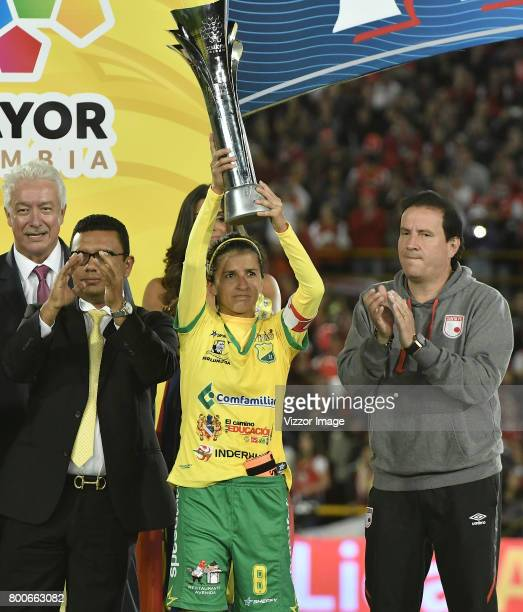 Miley Arevalo of Atletico Huila celebrates with her second place trophy after a second leg match between Independiente Santa Fe and Atletico Huila as...