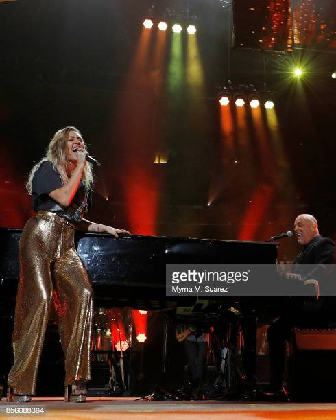 Miley Cyrus and Billy Joel perform at Madison Square Garden on September 30 2017 in New York City