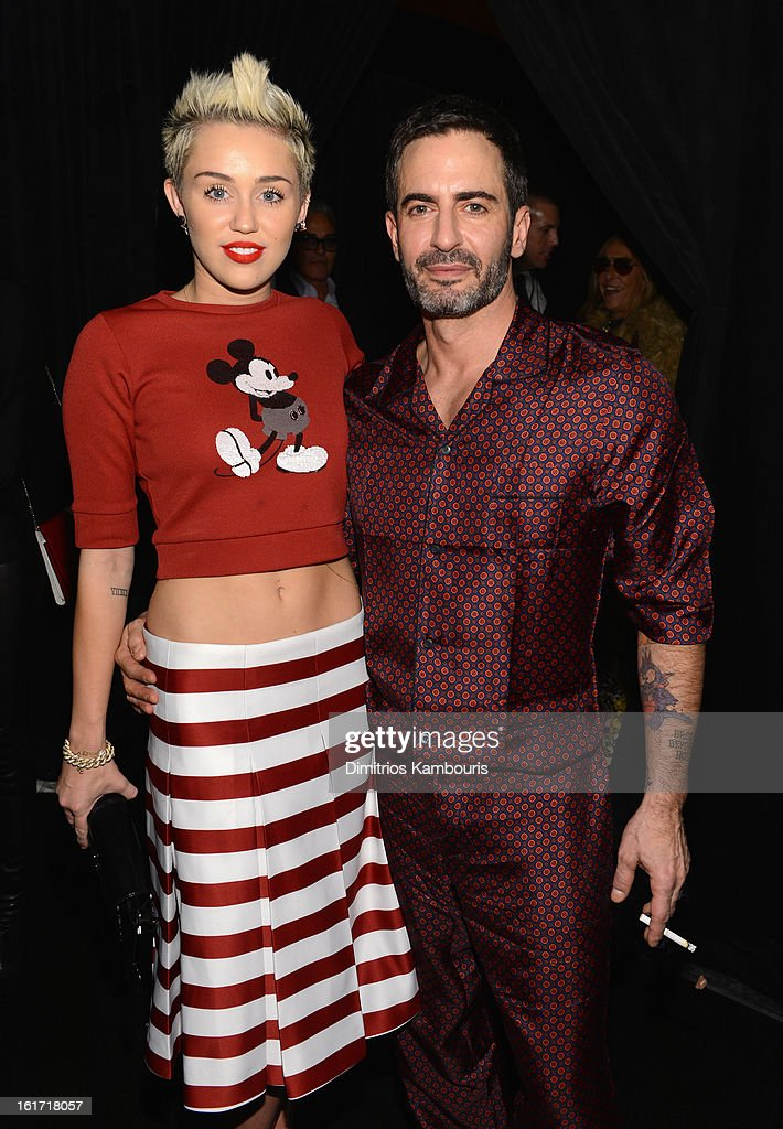 <a gi-track='captionPersonalityLinkClicked' href=/galleries/search?phrase=Miley+Cyrus&family=editorial&specificpeople=3973523 ng-click='$event.stopPropagation()'>Miley Cyrus</a> (L) and designer Marc Jacobs pose backstage at the Marc Jacobs Collection Fall 2013 fashion show during Mercedes-Benz Fashion Week at New York Armory on February 14, 2013 in New York City.