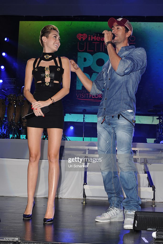 Miley Cyrus and Enrique Iglesias attend the iHeartRadio Ultimate Pool Party Presented By VISIT FLORIDA At Fontainebleau's BleauLive at Fontainebleau Miami Beach on June 29, 2013 in Miami Beach, Florida.