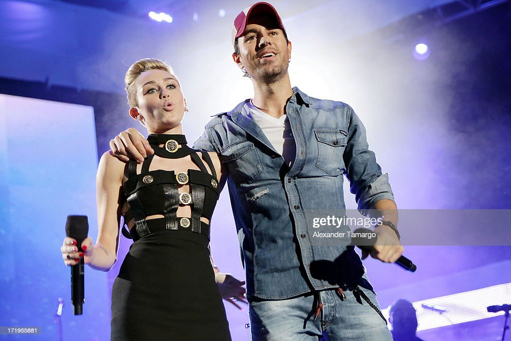 <a gi-track='captionPersonalityLinkClicked' href=/galleries/search?phrase=Miley+Cyrus&family=editorial&specificpeople=3973523 ng-click='$event.stopPropagation()'>Miley Cyrus</a> and <a gi-track='captionPersonalityLinkClicked' href=/galleries/search?phrase=Enrique+Iglesias+-+Singer&family=editorial&specificpeople=202672 ng-click='$event.stopPropagation()'>Enrique Iglesias</a> perform at the iHeartRadio Ultimate Pool Party Presented By VISIT FLORIDA at Fontainebleau Miami Beach on June 29, 2013 in Miami Beach, Florida.