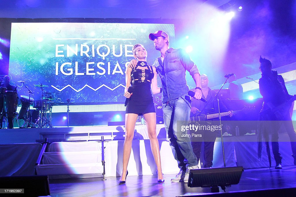 Miley Cyrus and Enrique Iglesias speak onstage at the iHeartRadio Ultimate Pool Party Presented by VISIT FLORIDA at Fontainebleau's BleauLive in Miami on June 29, 2013 in Miami Beach, Florida.