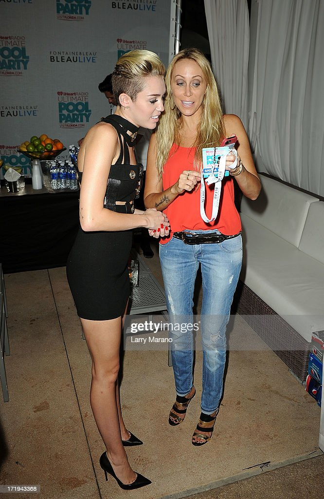 Miley Cyrus and her mother Tish Cyrus are seen backstage at the iHeartRadio Ultimate Pool Party Presented by VISIT FLORIDA at Fontainebleau's BleauLive in Miami on June 29, 2013 in Miami Beach, Florida.