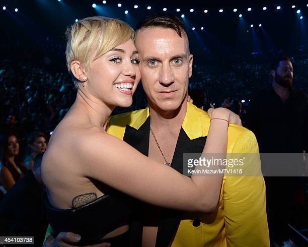 Miley Cyrus and Jeremy Scott attend the 2014 MTV Video Music Awards at The Forum on August 24 2014 in Inglewood California