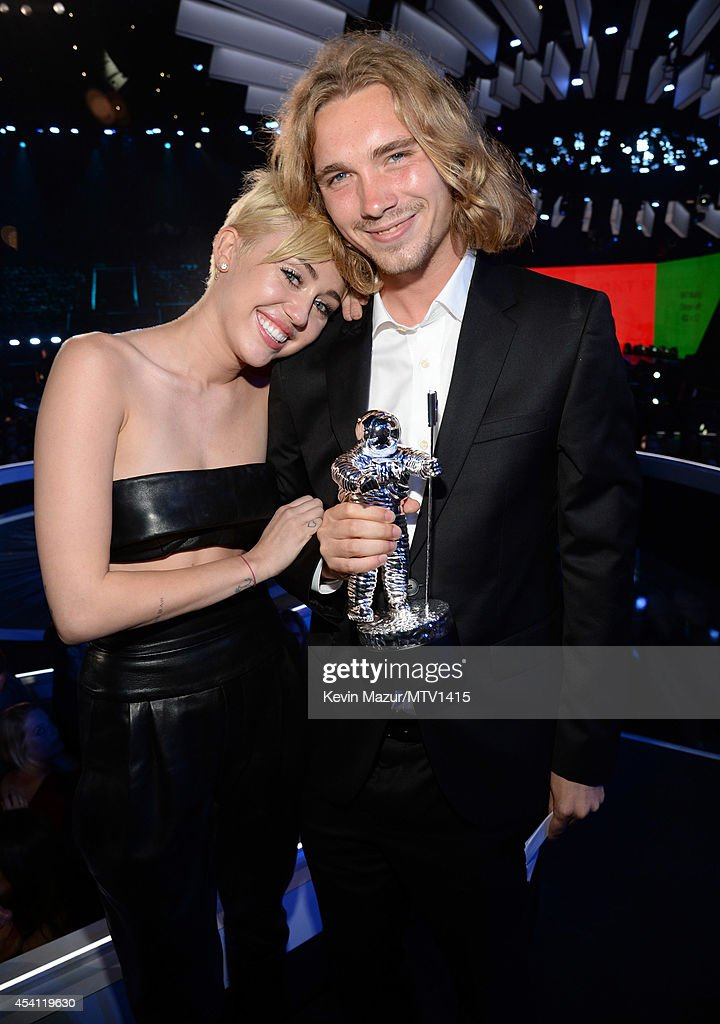 Miley Cyrus and Jesse Helt attend the 2014 MTV Video Music Awards at The Forum on August 24, 2014 in Inglewood, California.