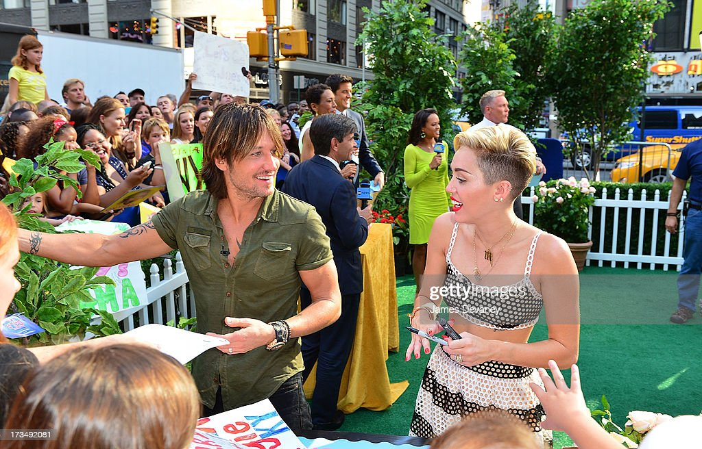Miley Cyrus and Keith Urban (L) visit ABC's 'Good Morning America' on July 15, 2013 in New York, United States.