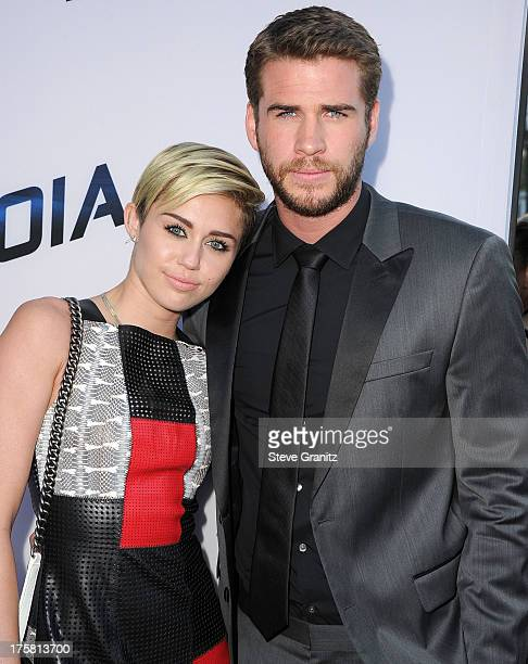 Miley Cyrus and Liam Hemsworth arrives at the 'Paranoia' Los Angeles Premiere at DGA Theater on August 8 2013 in Los Angeles California