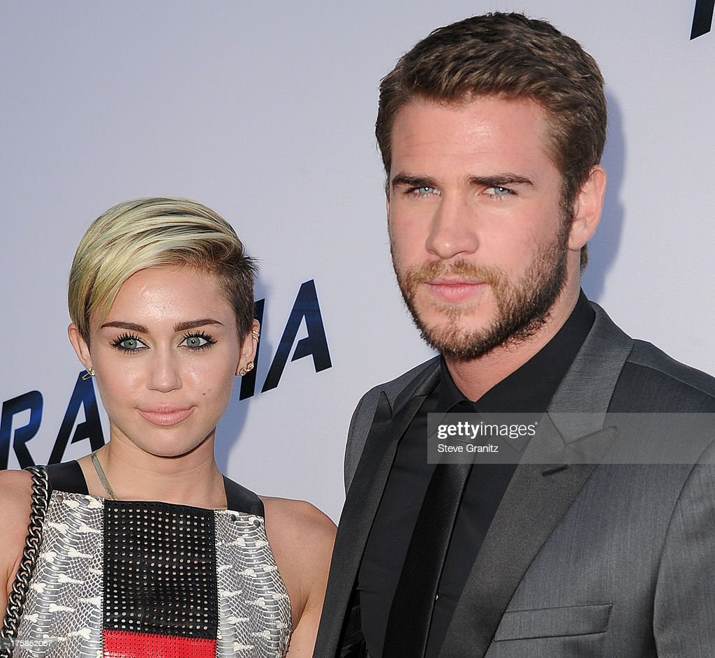 MIley Cyrus and <a gi-track='captionPersonalityLinkClicked' href=/galleries/search?phrase=Liam+Hemsworth&family=editorial&specificpeople=6338547 ng-click='$event.stopPropagation()'>Liam Hemsworth</a> arrives at the 'Paranoia' - Los Angeles Premiere at DGA Theater on August 8, 2013 in Los Angeles, California.